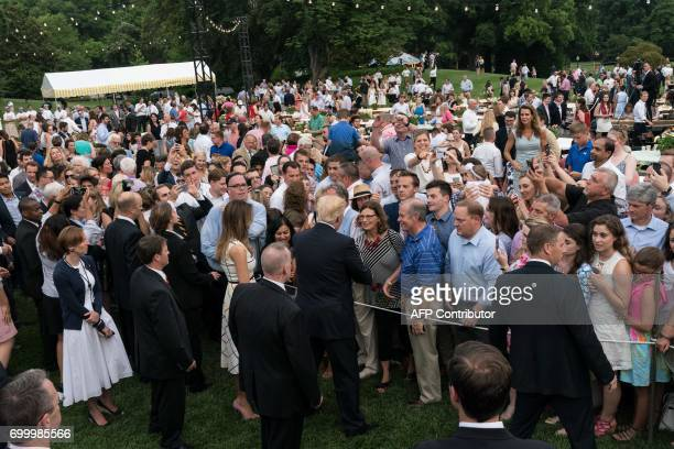 US President Donald Trump and First Lady Melania Trump greet guests at the Congressional picnic at the White House in Washington DC on June 22 2017 /...
