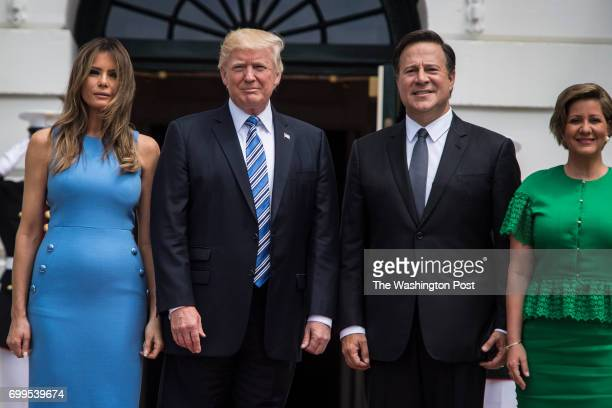 President Donald Trump and first lady Melania Trump greet Panamanian President Juan Carlos Varela and his wife Lorena Castillo on the South Lawn of...