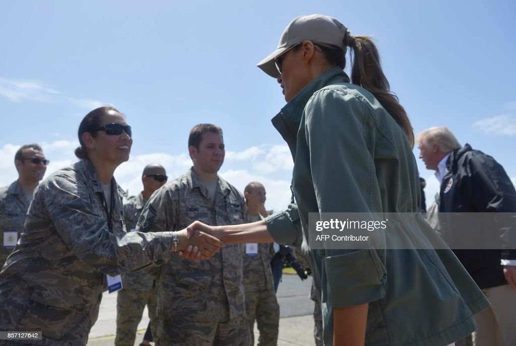 US President Donald Trump and First Lady Melania Trump greets military personnel upon arrival at Luis Muñiz Air National Guard Base in Carolina, Puerto Rico on October 3, 2017. Nearly two weeks after Hurricane Maria thrashed through the US territory, much of the islands remains short of food and without access to power or drinking water. /
