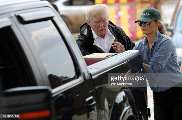 S President Donald Trump and first lady Melania Trump hand out emergency supplies to residents impacted by Hurricane Harvey while visiting the First...