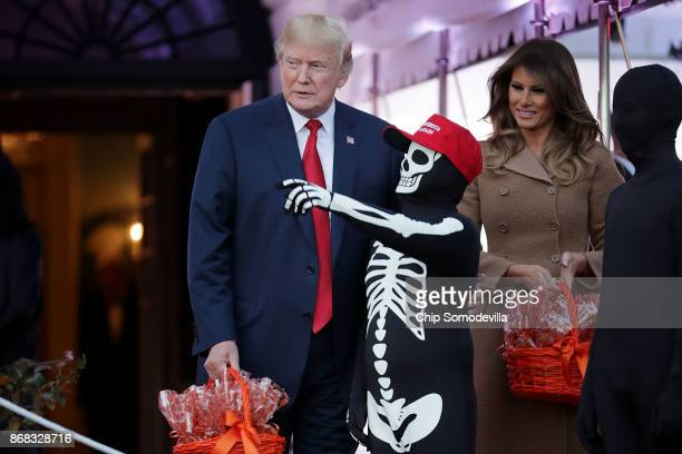S President Donald Trump and first lady Melania Trump host Halloween at the White House on the South Lawn October 30 2017 in Washington DC The first...