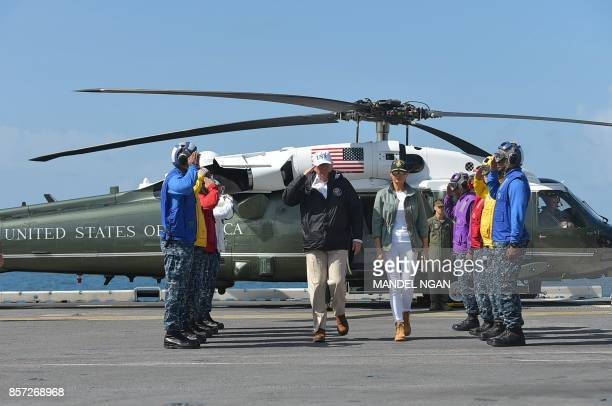 President Donald Trump and first lady Melania Trump is greeted upon arrival on the USS Kearsarge off Puerto Rico on October 3 2017 Nearly two weeks...