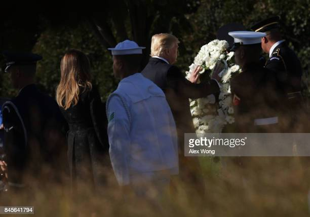 S President Donald Trump and first lady Melania Trump lay a wreath during an observance to commemorate the anniversary of the 9/11 terror attacks at...