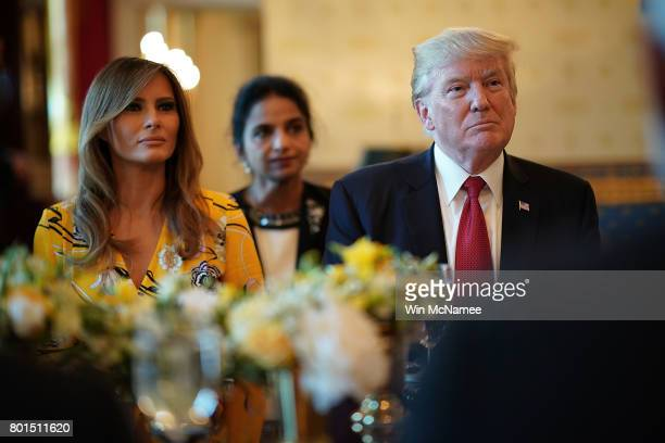 S President Donald Trump and first lady Melania Trump listen as Indian Prime Minister Narendra Modi delivers remarks during dinner at the White House...