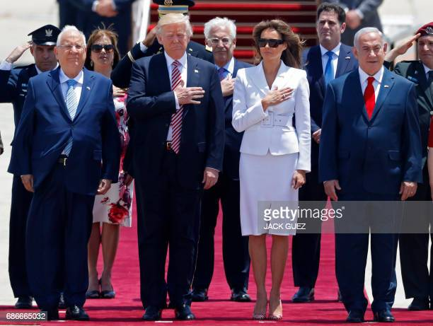 President Donald Trump and First Lady Melania Trump listen to the their national anthem as they are welcomed by Israeli Prime Minister Benjamin...