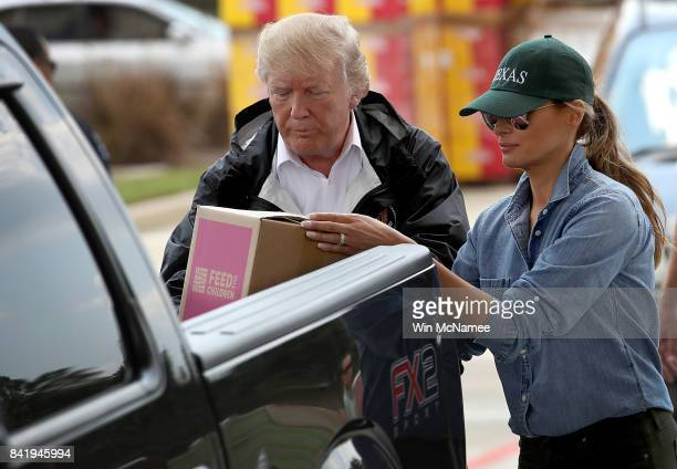S President Donald Trump and first lady Melania Trump load emergency supplies into the back of a pickup truck for residents impacted by Hurricane...