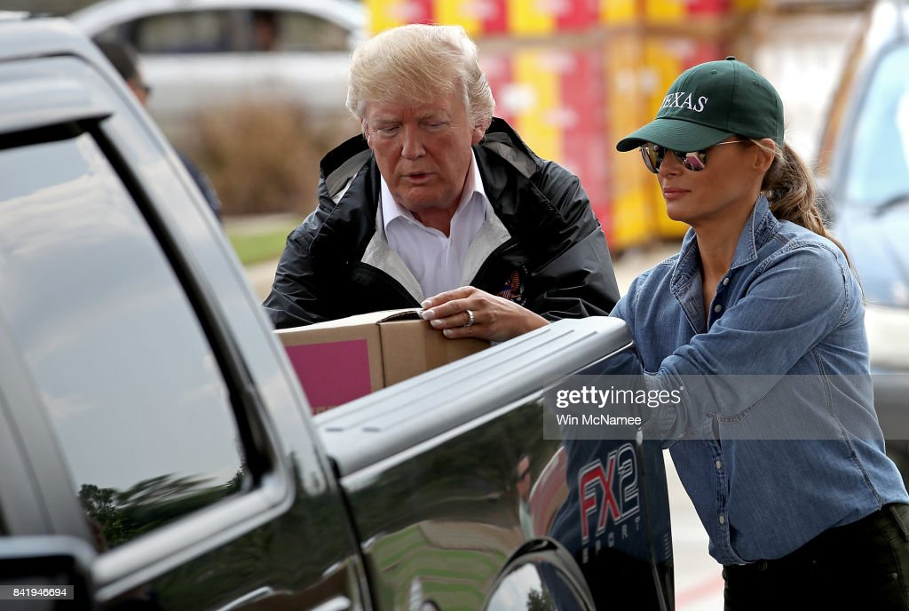 U.S. President Donald Trump and first lady Melania Trump load emergency supplies into the bed of a pickup truck for residents impacted by Hurricane Harvey while visiting the First Church of Pearland September 2, 2017 in Pearland, Texas. Pearland, just south of Houston, was heavily damaged by the floodwaters created by the hurricane.