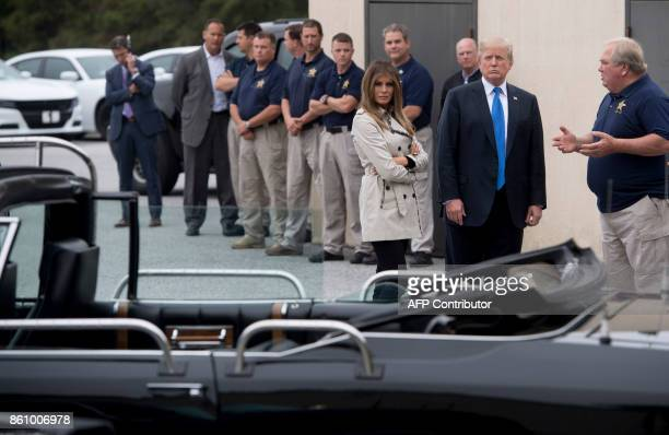 US President Donald Trump and First Lady Melania Trump look at a 1983 Cadillac limousine used by former President Ronald Reagan at the United States...