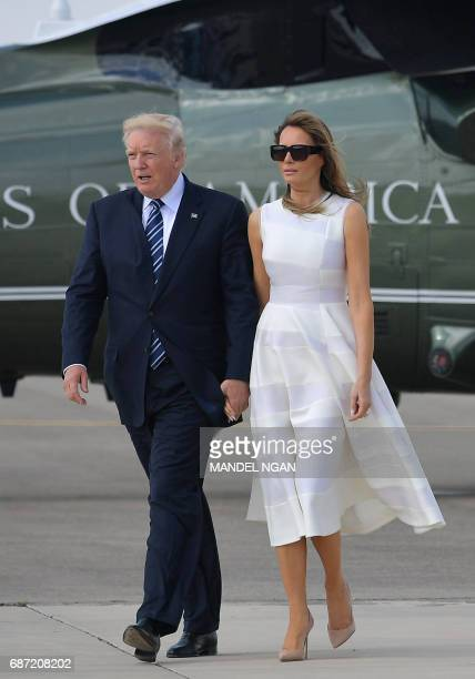 US President Donald Trump and First Lady Melania Trump make their way to board Air Force One before departing from Ben Gurion International Airport...