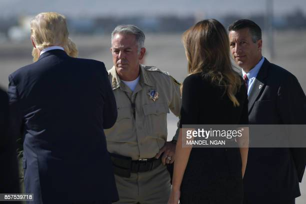 US President Donald Trump and First Lady Melania Trump meet Las Vegas Sherif Joseph Lombardo as they step off Air Force One upon arrival at McCarran...