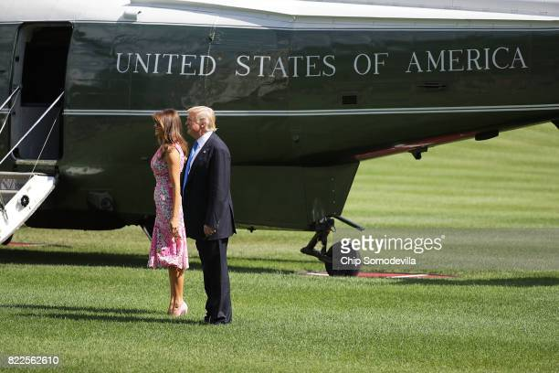President Donald Trump and first lady Melania Trump pause on the South Lawn before departing the White House July 25 2017 in Washington DC Trump is...