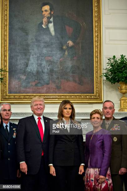 S President Donald Trump and first lady Melania Trump pose for pictures with senior military leaders and spouses including including Gen Joseph...