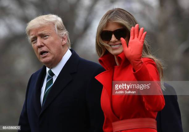 S President Donald Trump and First Lady Melania Trump prepare to depart the White House on March 17 2017 in Washington DC President Trump is spending...