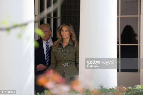 President Donald Trump and First Lady Melania Trump prepare to walk through the West Wing Colonnade to the Oval office of the White House in...