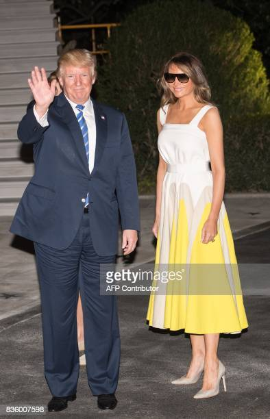 US President Donald Trump and First Lady Melania Trump return to the White House in Washington DC on August 20 2017 after a 17day 'working vacation'...