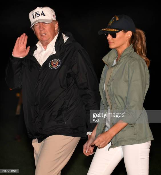 S President Donald Trump and first lady Melania Trump return to the White House after a day trip to Puerto Rico where they viewed damage from...