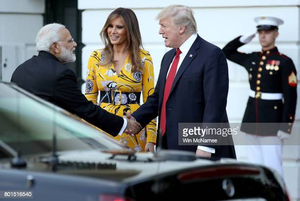 S President Donald Trump and first lady Melania Trump see off Indian Prime Minister Narendra Modi as he departs the White House June 26 2017 in...