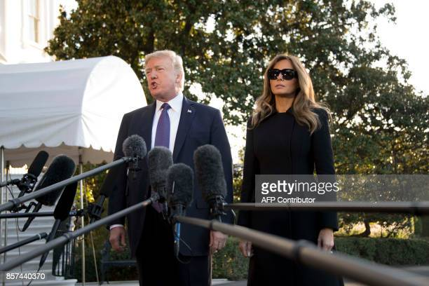 US President Donald Trump and First Lady Melania Trump speak to the press as they depart the White House in Washington DC October 4 to travel to Las...