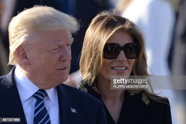 US President Donald Trump and First Lady Melania Trump step off Air Force One upon arrival at Rome's Fiumicino Airport on May 23 2017 Donald Trump...