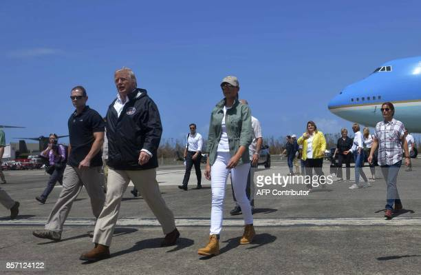 US President Donald Trump and First Lady Melania Trump step off Air Force One upon arrival at Luis Muñiz Air National Guard Base in Carolina Puerto...