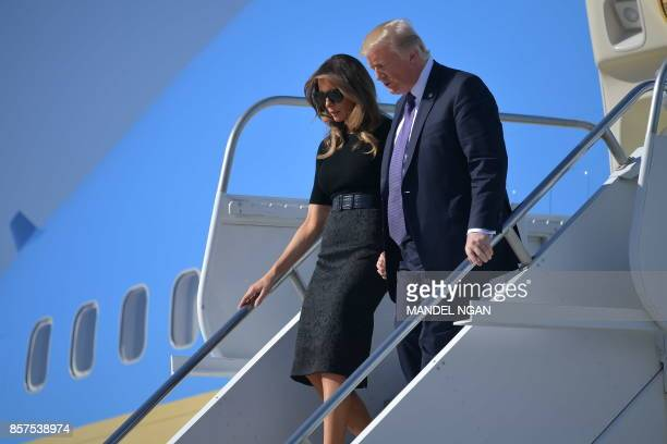 US President Donald Trump and First Lady Melania Trump step off Air Force One upon arrival at McCarran International Airport in Las Vegas on October...