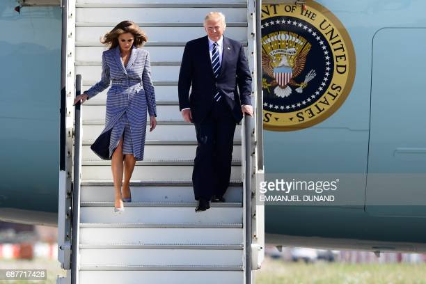 US President Donald Trump and First Lady Melania Trump step off the Air Force One upon arrival at Melsbroek military airport in Steenokkerzeel on May...
