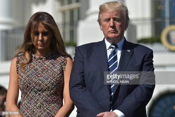 US President Donald Trump and First Lady Melania Trump take part in a moment of silence for the victims of the Las Vegas shootings on the South Lawn...