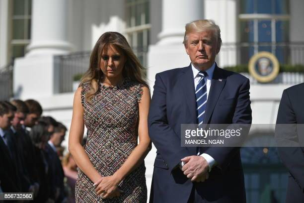 US President Donald Trump and First Lady Melania Trump take part in a moment of silence with White House staff for the victims of the Las Vegas...