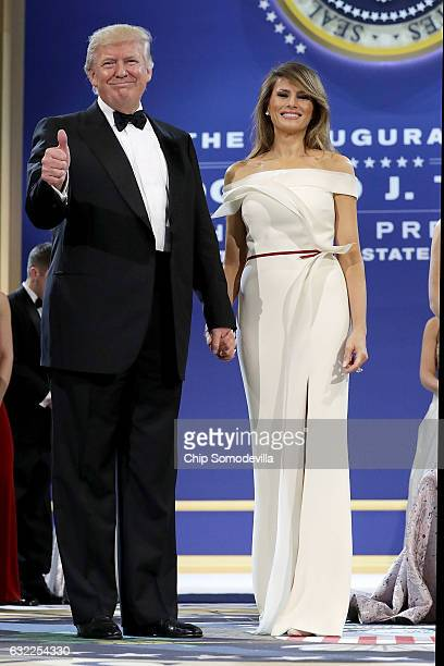S President Donald Trump and first lady Melania Trump thank guests during the inaugural Armed Forces Ball at the National Building Museum January 20...