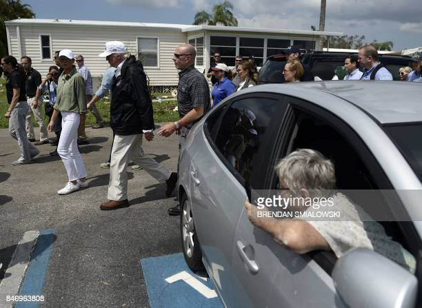 US President Donald Trump and VFirst Lady Melania Trump tour a neighborhood affected by Hurricane Irma in Naples Florida on September 14 2017 / AFP...