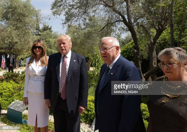 US President Donald Trump and First Lady Melania Trump tour the garden of the residency of Israel's President Reuven Rivlin alongside Rivlin's wife...