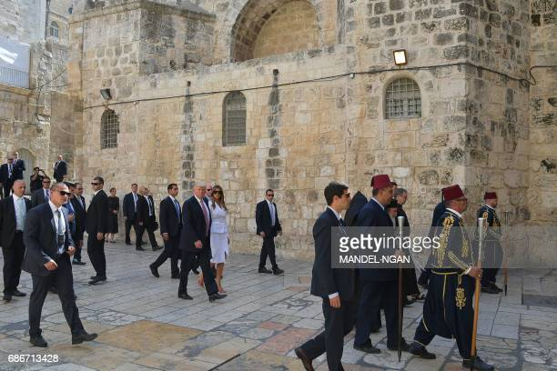 US President Donald Trump and First Lady Melania Trump visit the Church of the Holy Sepulchre in Jerusalems Old City on May 22 2017 / AFP PHOTO /...