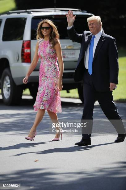 President Donald Trump and first lady Melania Trump walk across the South Lawn before departing the White House July 25 2017 in Washington DC Trump...