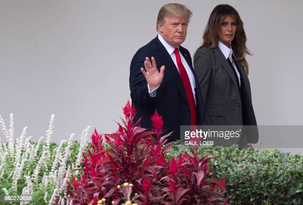 US President Donald Trump and First Lady Melania Trump walk across the West Wing Colonnade at the White House in Washington DC on October 11 2017 /...