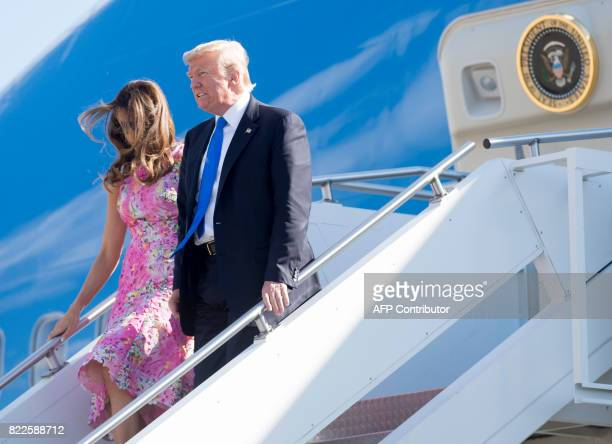 US President Donald Trump and First Lady Melania Trump walk from Air Force One upon arrival at YoungstownWarren Regional Airport in Vienna Ohio July...