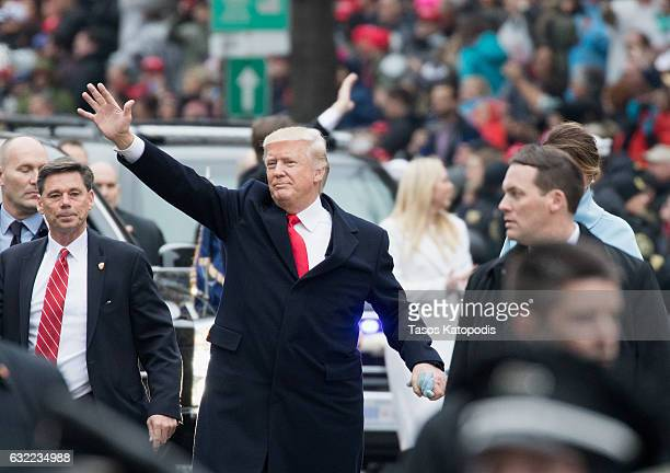 President Donald Trump and first lady Melania Trump walk in the Inaugural Parade on January 20 2017 in Washington DC Donald J Trump was sworn in...