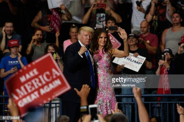S President Donald Trump and first lady Melania Trump walk off the stage after a rally at the Covelli Centre on July 25 2017 in Youngstown Ohio The...