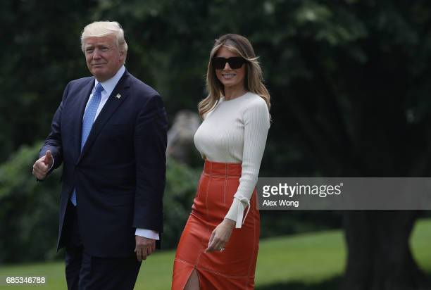 S President Donald Trump and first lady Melania Trump walk on the South Lawn prior to their departure from the White House May 19 2017 in Washington...