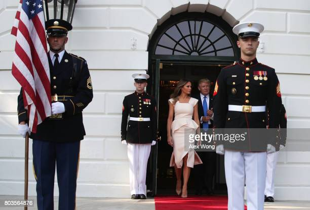 S President Donald Trump and first lady Melania Trump walk out to welcome South Korean President Moon Jaein and his wife Kim Jungsook at the South...