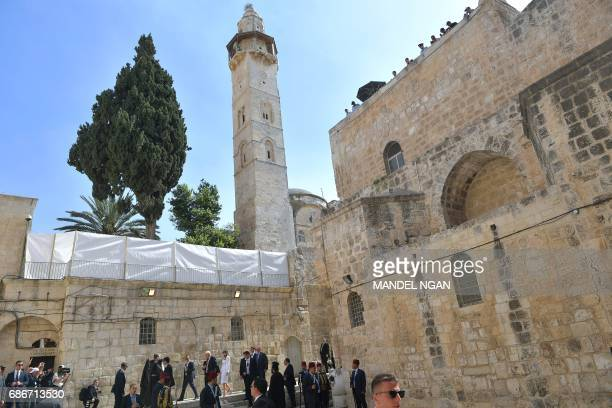 US President Donald Trump and First Lady Melania Trump walk outside the Church of the Holy Sepulchre in Jerusalems Old City on May 22 2017 / AFP...