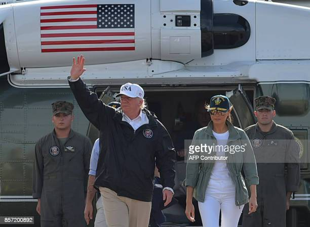 US President Donald Trump and First Lady Melania Trump walk to Air Force One before departing from Luis Muñiz Air National Guard Base in Carolina...