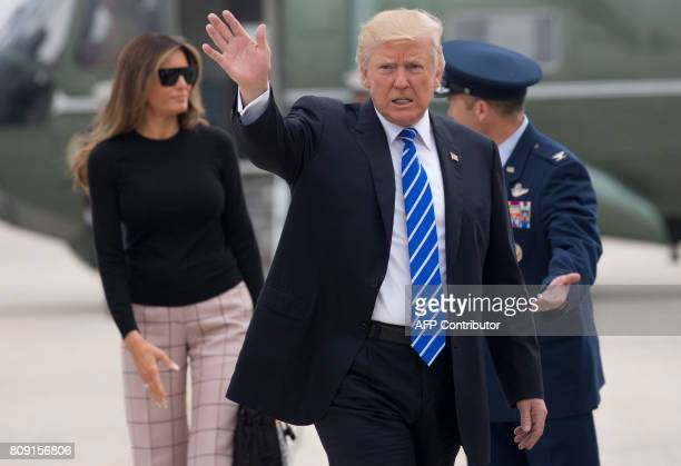 US President Donald Trump and First Lady Melania Trump walk to board Air Force One prior to departure from Andrews Air Force Base in Maryland July 5...