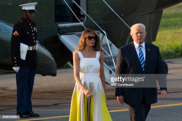 US President Donald Trump and First Lady Melania Trump walk to board Air Force One prior to departure from Morristown Municipal Airport in Morristown...
