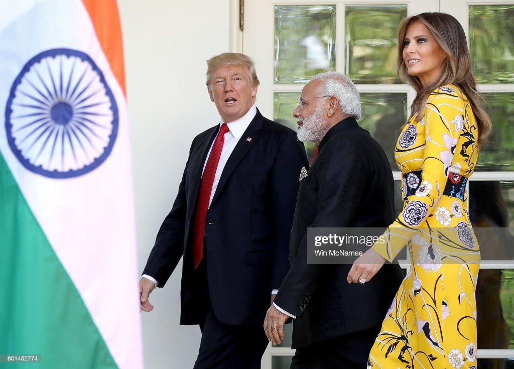 U.S. President Donald Trump (L) and first lady Melania Trump (R) walk to the Oval Office with Indian Prime Minister Narendra Modi (C) at the White House June 26, 2017 in Washington, DC. Trump and Modi are scheduled to meet in the Oval Office later today and discuss a range of bilateral issues.