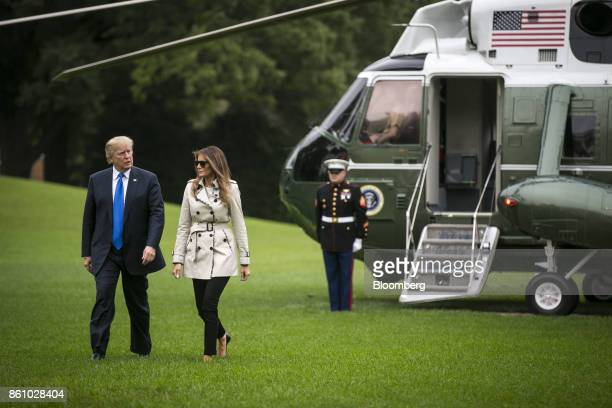 US President Donald Trump and First Lady Melania Trump walk towards the White House on the South Lawn after disembarking Marine One in Washington DC...