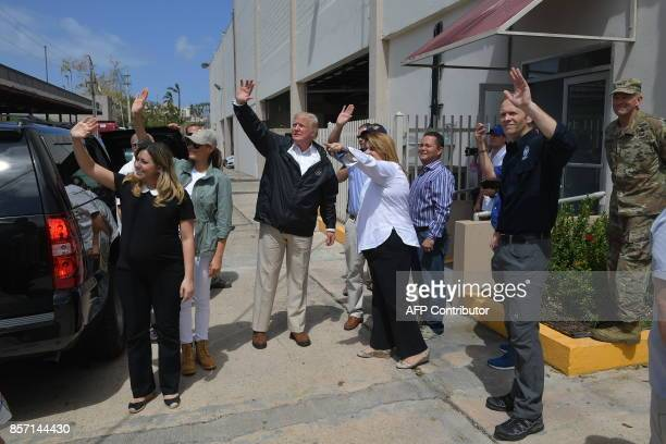 US President Donald Trump and First Lady Melania Trump wave after visiting residents affected by Hurricane in Guaynabo west of San Juan Puerto Rico...