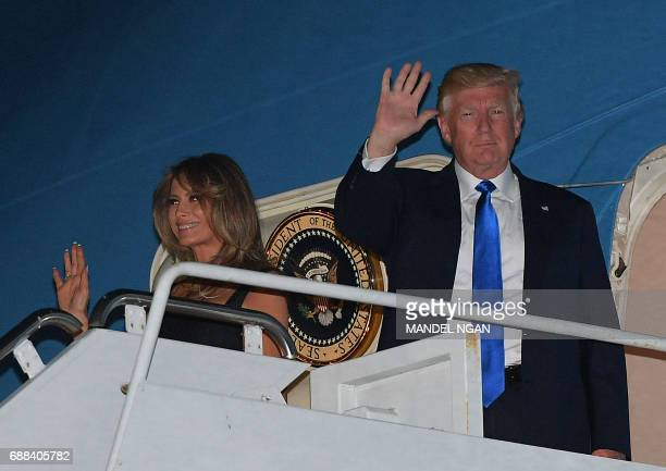 US President Donald Trump and First lady Melania Trump wave after arriving in US Naval Air Station Sigonella Sicily on May 25 for the G7 summit / AFP...