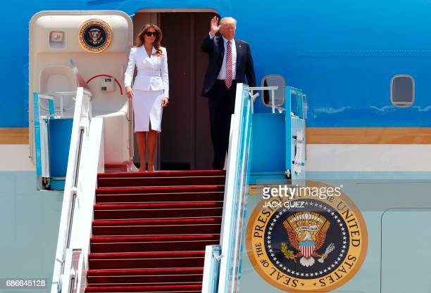 US President Donald Trump and First Lady Melania Trump wave as they disembark Air Force One upon their arrival at Ben Gurion International Airport in...