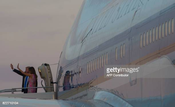 US President Donald Trump and First Lady Melania Trump wave from Air Force One prior to departure from YoungstownWarren Regional Airport in Vienna...