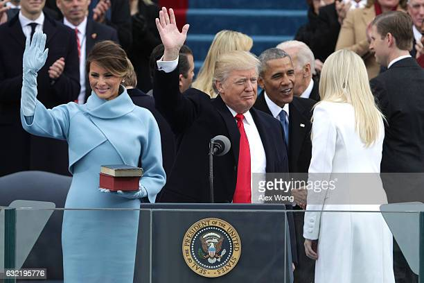 President Donald Trump and First Lady Melania Trump wave to the crowd as former president Barack Obama greets Tiffany Trump on the West Front of the...